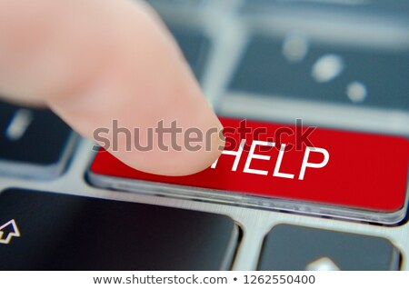 pressing red button live help on black keyboard stock photo © tashatuvango