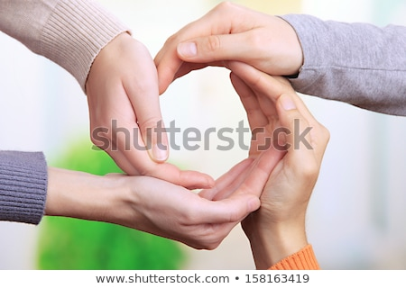 Human hands making circle on bright background Stock photo © tetkoren