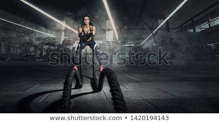 女性 筋骨たくましい体 筋肉の 女性 訓練 ダンベル ストックフォト © alphaspirit