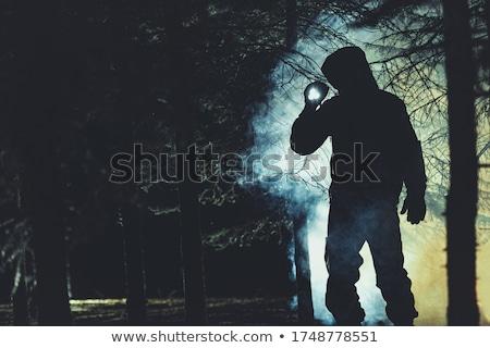 rescuer with flashlight Stock photo © Paha_L