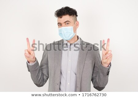 бизнесмен · улыбаясь · победу · рукой · знак · портрет - Сток-фото © ozgur