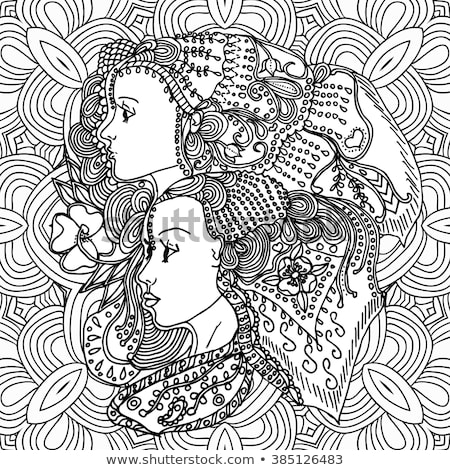 Colouring book used by two happy sisters for drawing Stock photo © deandrobot