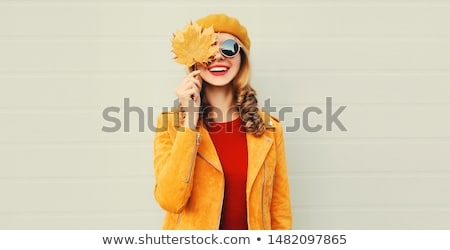 Stock photo: Beautiful woman smiling over grey background