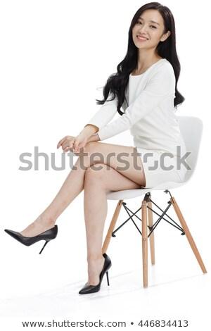 Femme longues jambes séance président isolé blanche Photo stock © Nobilior