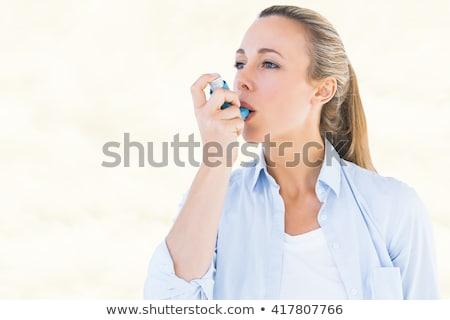composite image of asthmatic pretty blonde woman using inhaler stock photo © wavebreak_media