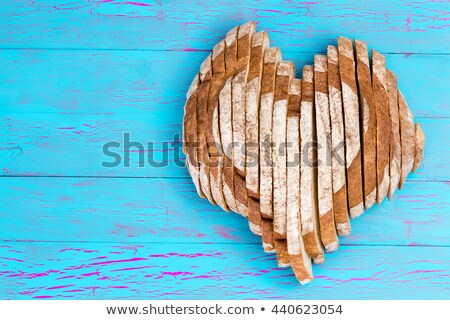 sliced bread loaf shaped as heart over old surface stock photo © ozgur