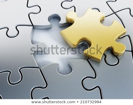 Ouro peças do puzzle branco assinar quebra-cabeça sucesso Foto stock © Oakozhan