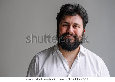 Portrait of a charming brunette man looking at camera Stock photo © deandrobot