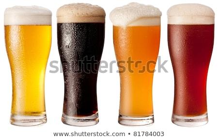 Dört cam soğuk bira köpük siyah Stok fotoğraf © stokato