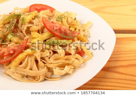 Rigatoni Pasta with a Tomato and Pancetta Sauce Stock photo © monkey_business