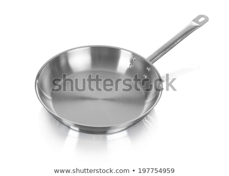 large metal frying pan image is taken over a white background stock photo © kayros