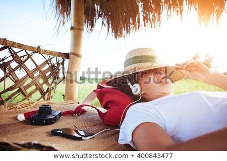 Boldog fiatal nő kalap zenét hallgat klasszikus zene Stock fotó © Fisher