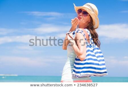 tourist woman on tropical beach blowing kiss stock photo © kzenon