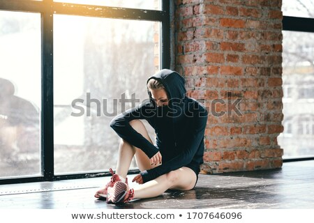 Calm female fighter looking down Stock photo © deandrobot