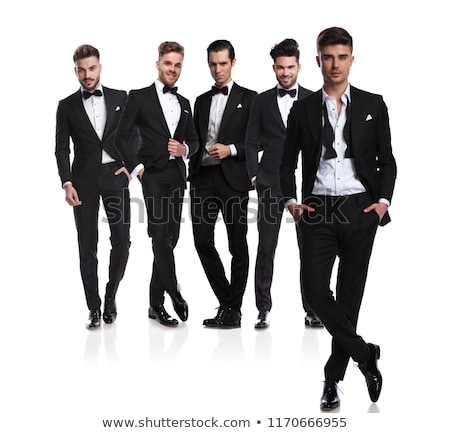 man in tuxedo and undone bowtie standing with hands in pockets  Stock photo © feedough