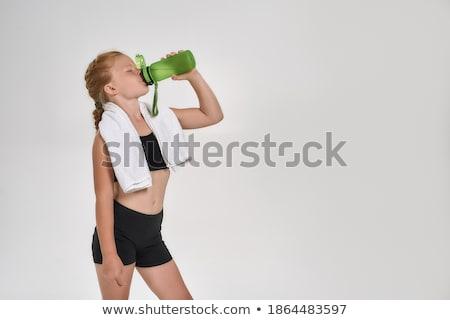 Cute sportlich Mädchen Trinkwasser Flasche Aktivitäten Stock foto © LightFieldStudios