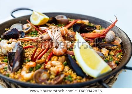 Zeevruchten voedsel achtergrond rijst garnalen spaans Stockfoto © M-studio
