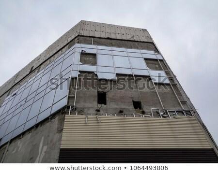 Befejezetlen elhagyatott beton épület homlokzat sötét Stock fotó © stevanovicigor