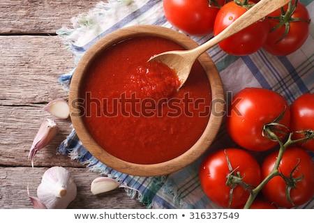 Salsa de tomate alimentos vidrio fondo tomate cereza Foto stock © yelenayemchuk