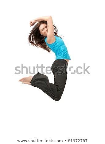 feliz · sorridente · mulher · jovem · saltando · ar - foto stock © dolgachov