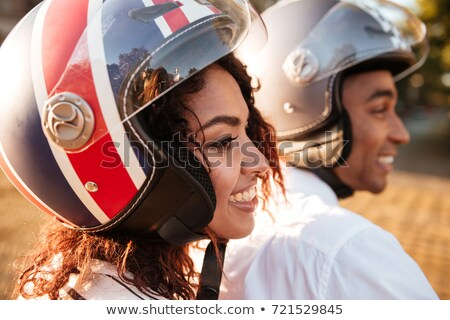 Close up image of pleased african couple rides on motorbike Stock photo © deandrobot