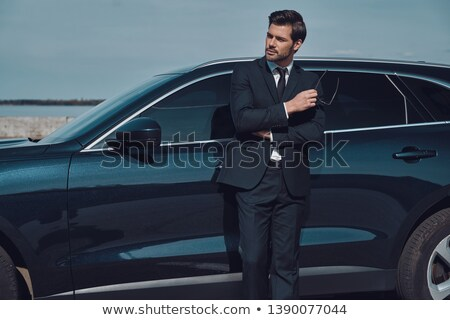 Man standing with arms crossed near his car Stock photo © wavebreak_media