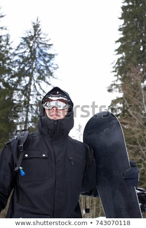 Guy in Technical winter gear, snowboard Stock photo © IS2