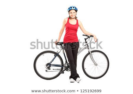 Woman standing next to bicycle Stock photo © IS2