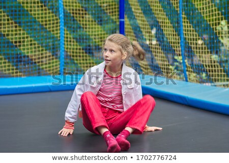Girl, 10 jumping on trampoline Stock photo © IS2