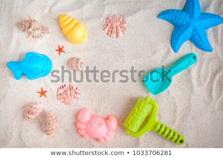 Playing with sand and digging the father in Stock photo © zurijeta