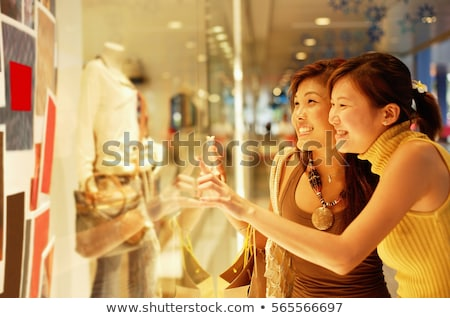 2 young women looking at jewelry stock photo © is2