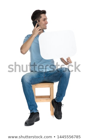 smiling casual man holding blank ad at his side Stock photo © feedough
