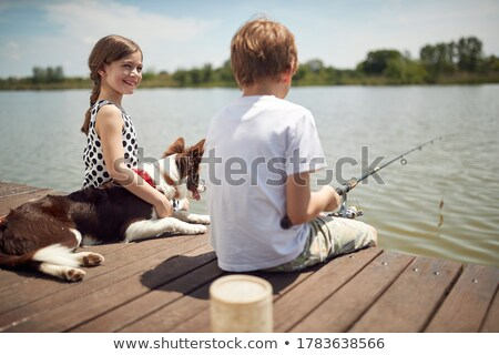 Girl fishing from a dock Stock photo © IS2