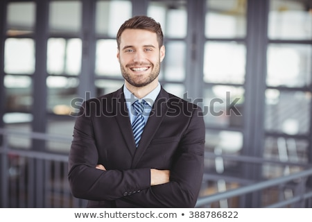 Metade retrato jovem empresário terno Foto stock © deandrobot