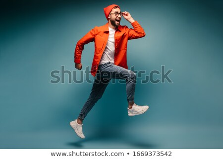 Portrait of a happy young man in jacket posing Stock photo © deandrobot
