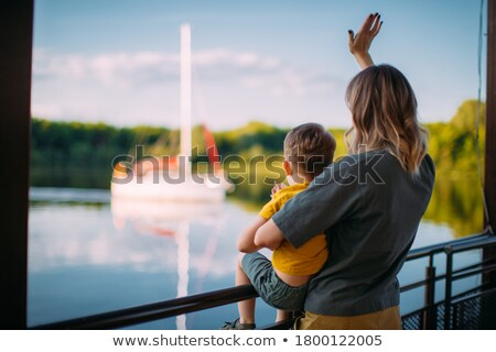 Young friends standing on jetty Stock photo © IS2