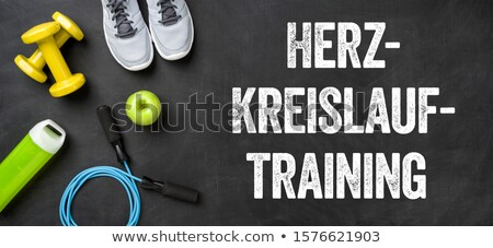 fitness equipment on a dark background   cardiovascular workout stock photo © zerbor