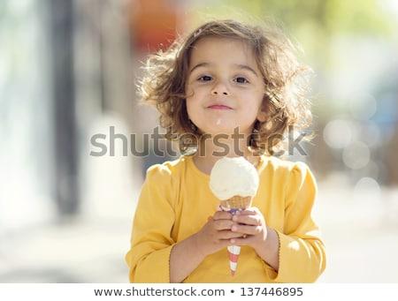 little girl eating ice cream stock photo © is2