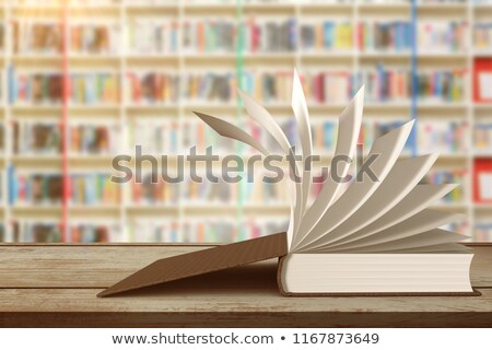 Surface of wooden plank against multi colored bookshelf in library stock photo © wavebreak_media