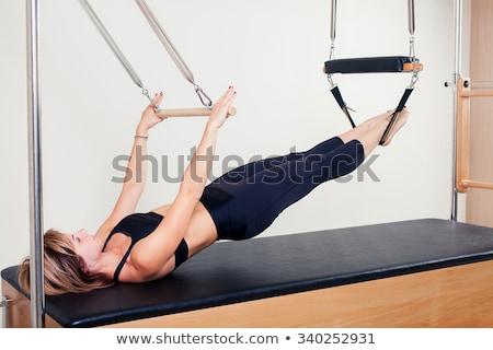 Foto stock: Gimnasio · pilates · mujer · yoga · pierna · deporte