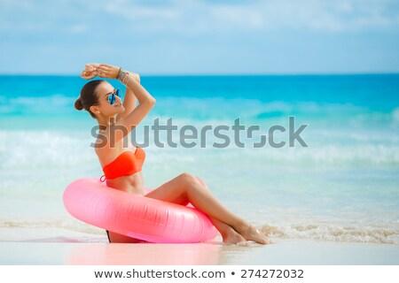 woman in swimwear posing holding beach rubber ring stock photo © deandrobot