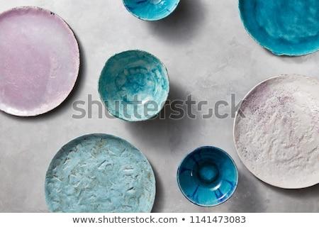 Azul bolos placas gris mesa Foto stock © artjazz
