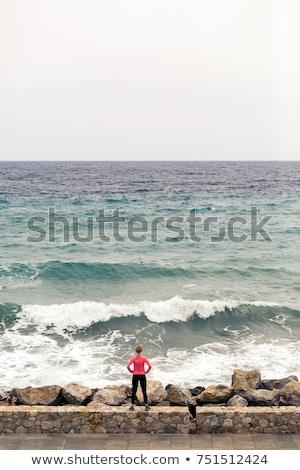 Runner on city street looking at inspiring sea view Stock photo © blasbike