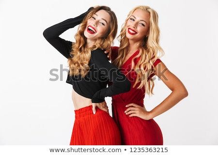 Portrait of two cheerful young smartly dressed women Stock photo © deandrobot
