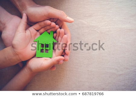 hands holding green paper house Stock photo © dolgachov