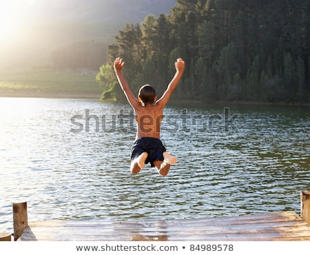Foto stock: Children Swimming In The River