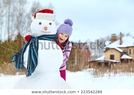 merry christmas holidays children building snowman stock photo © robuart