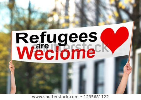 Two People Holding Refugees Are Welcome Banner Stock photo © AndreyPopov