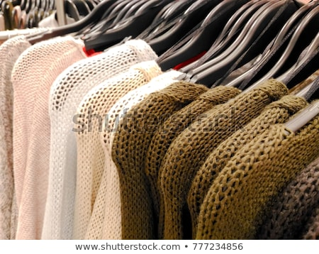 Warm knitted clothes hanging on a rack Stock photo © Lana_M