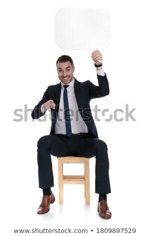 ülő elegáns férfi tart tábla mutat Stock fotó © feedough